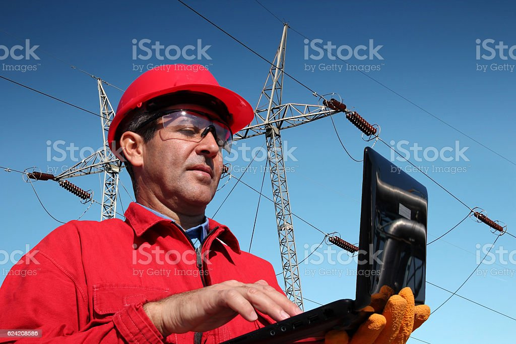Engineer Using Laptop Computer as Concept stock photo