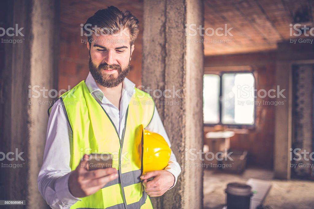 Engineer using smart phone stock photo