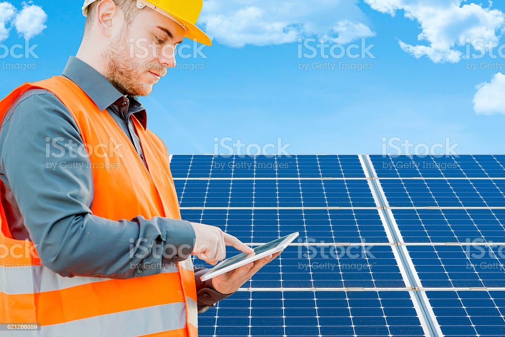 Engineer using tablet in solar power station stock photo