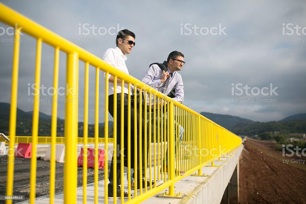 Engineer vs Manager - Economics vs Business stock photo