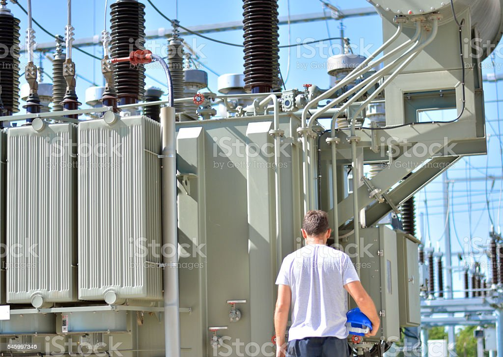 Engineer watching the high voltage transformer stock photo