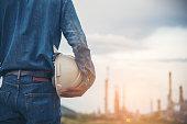 Engineer Wear Jeans Holding White Helmet refinery