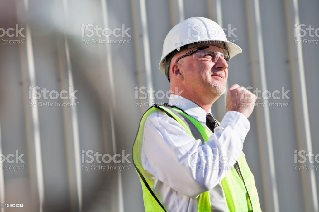 Engineer wearing hardhat at industrial facility royalty-free stock photo