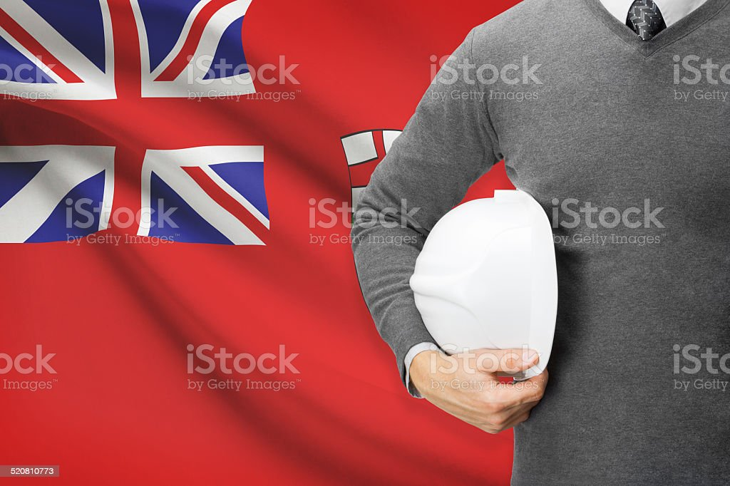 Engineer with flag on background series - Manitoba stock photo