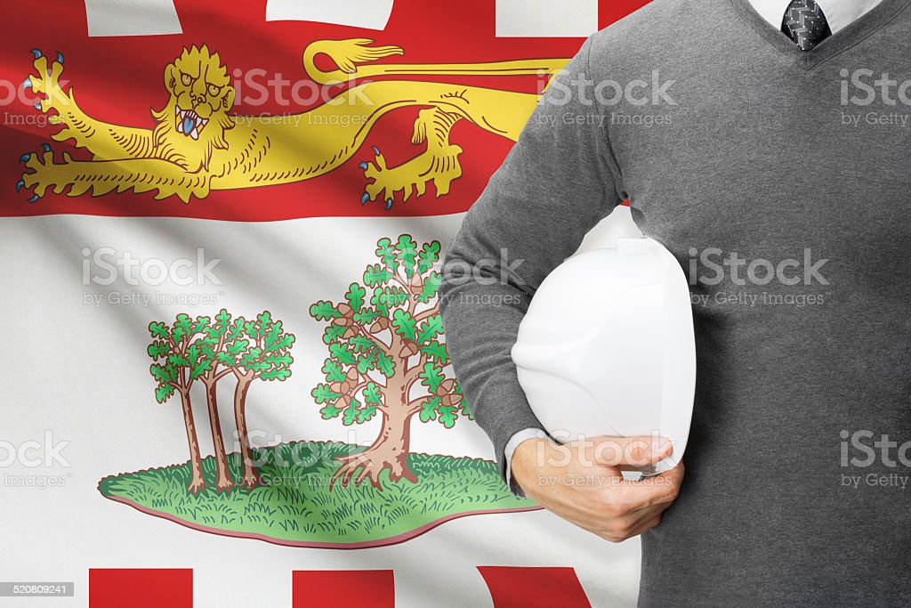 Engineer with flag on background series - Prince Edward Island stock photo