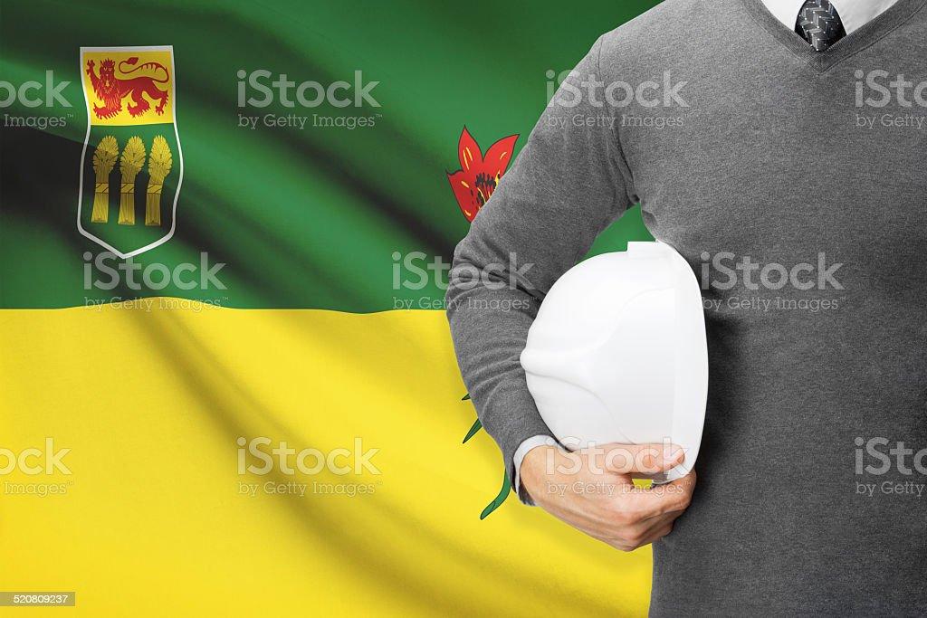 Engineer with flag on background series - Saskatchewan stock photo