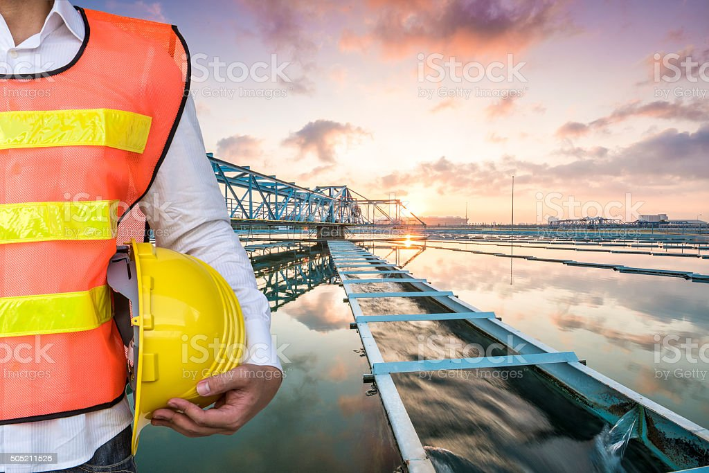 Engineer with The Solid Contact Clarifier Tank with sunrise stock photo