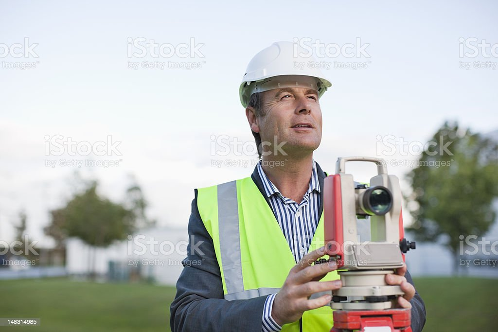Engineer with theodolite in field royalty-free stock photo