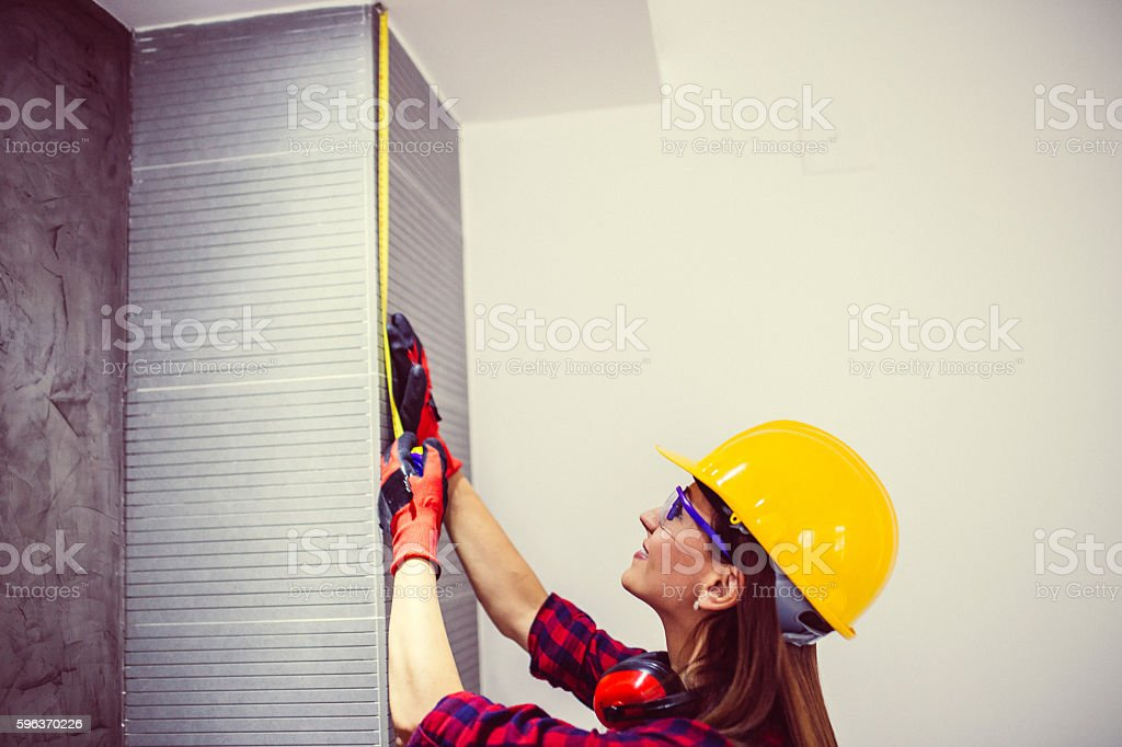Engineer woman holding a meter stock photo