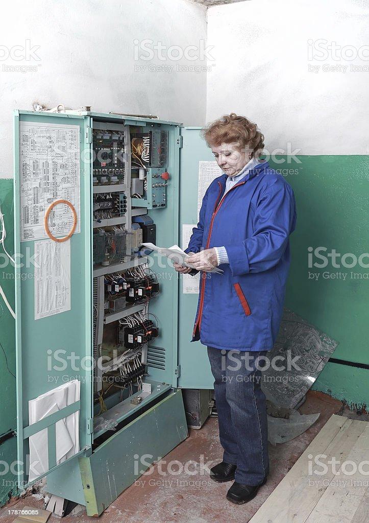 Engineer  woman in machine room (elevator) . royalty-free stock photo