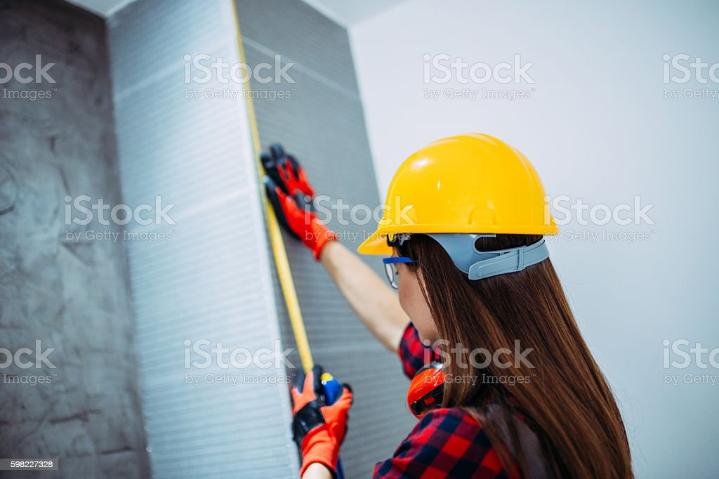 Engineer woman with a meter stock photo