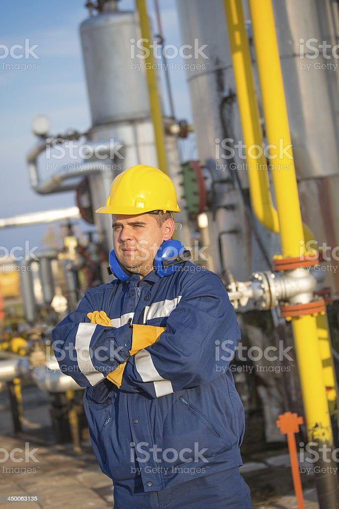 Engineer work in oil refinery royalty-free stock photo