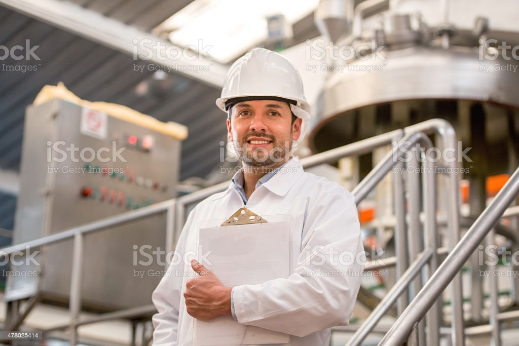 Engineer working at a factory stock photo