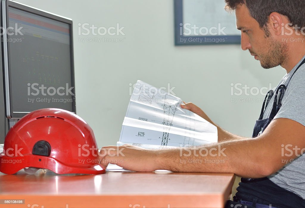 Engineer Working at the Desk stock photo