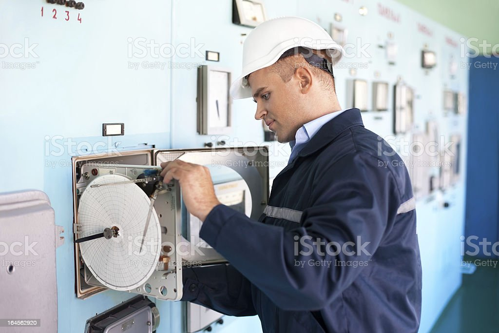 engineer working in control room royalty-free stock photo