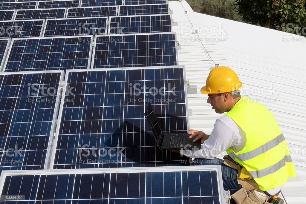 engineer working in solar power station. stock photo