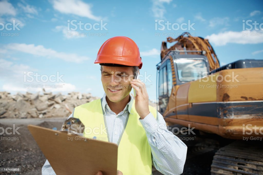 Engineer working on a construction site royalty-free stock photo