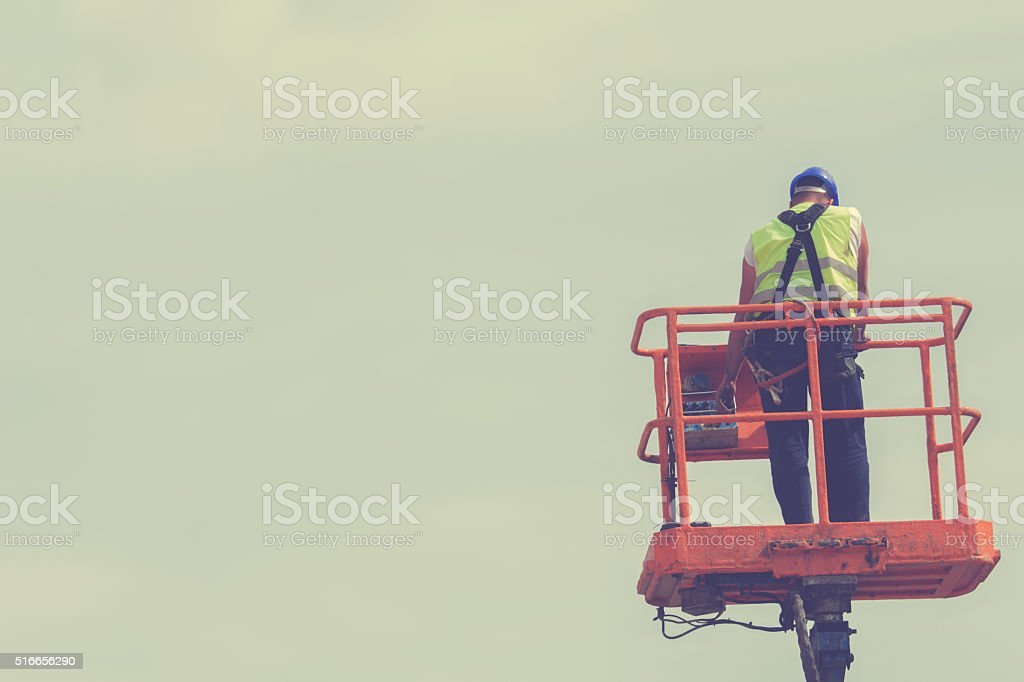 Engineer working on a lifter. stock photo