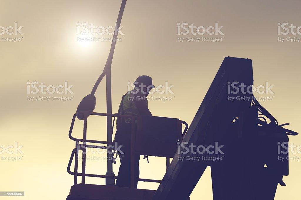 Engineer working on a light pole. stock photo