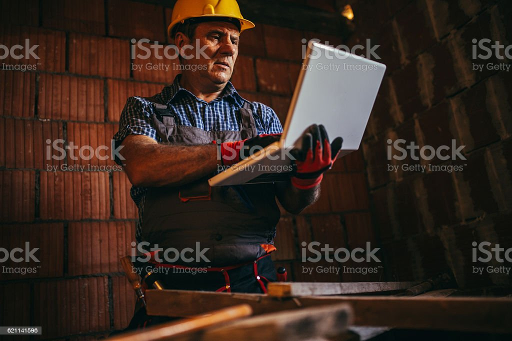 Engineer working on laptop stock photo