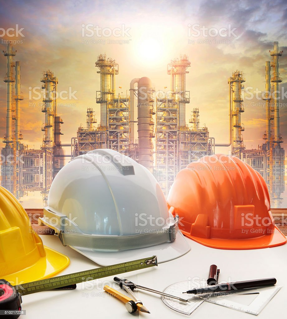engineer working table plan, and oil refinery plant stock photo