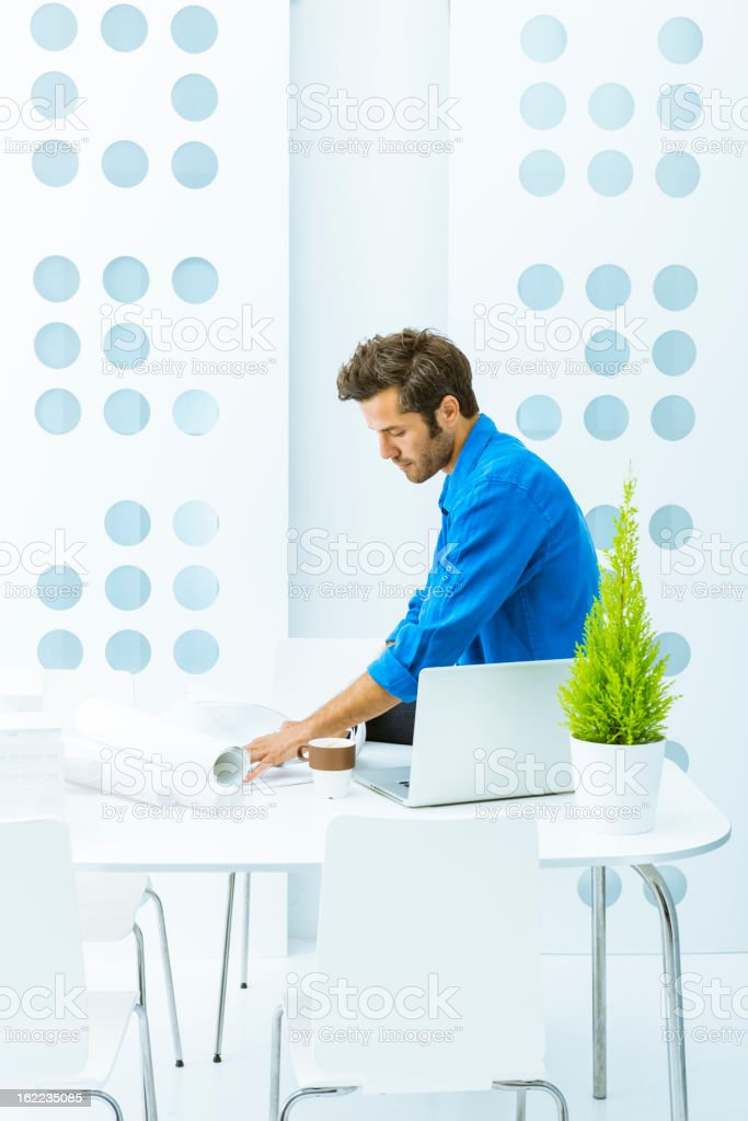Engineer working with blueprints royalty-free stock photo