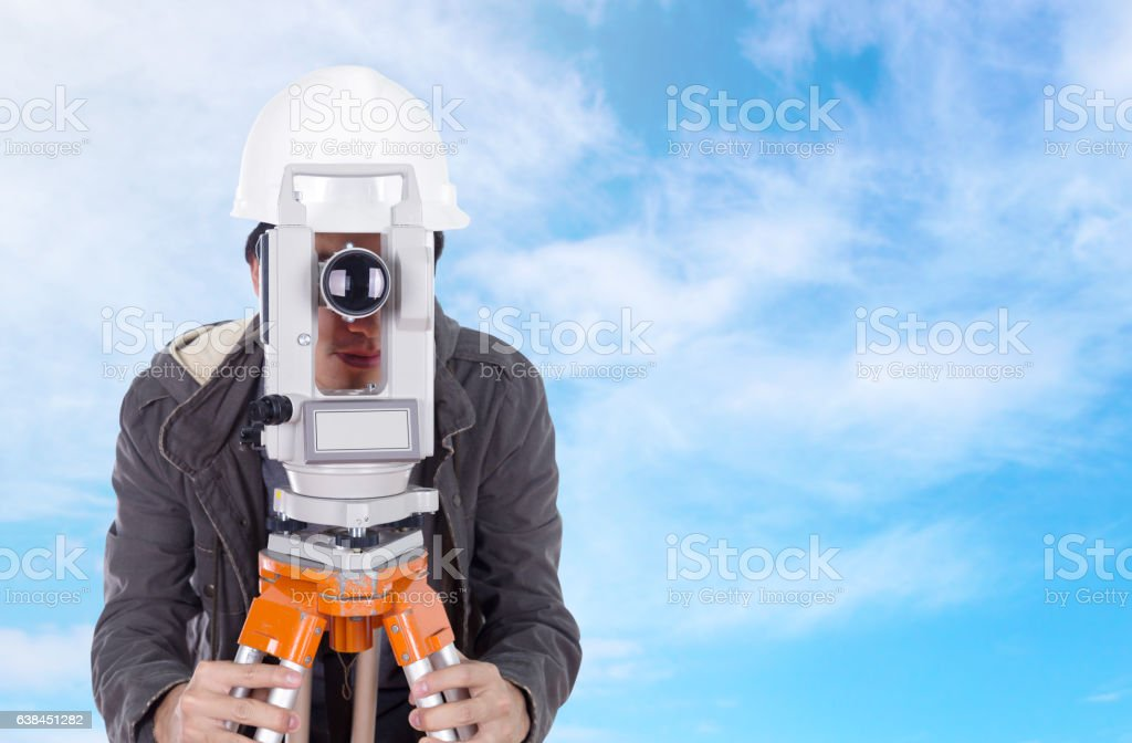 engineer working with survey equipment theodolite with blue sky stock photo