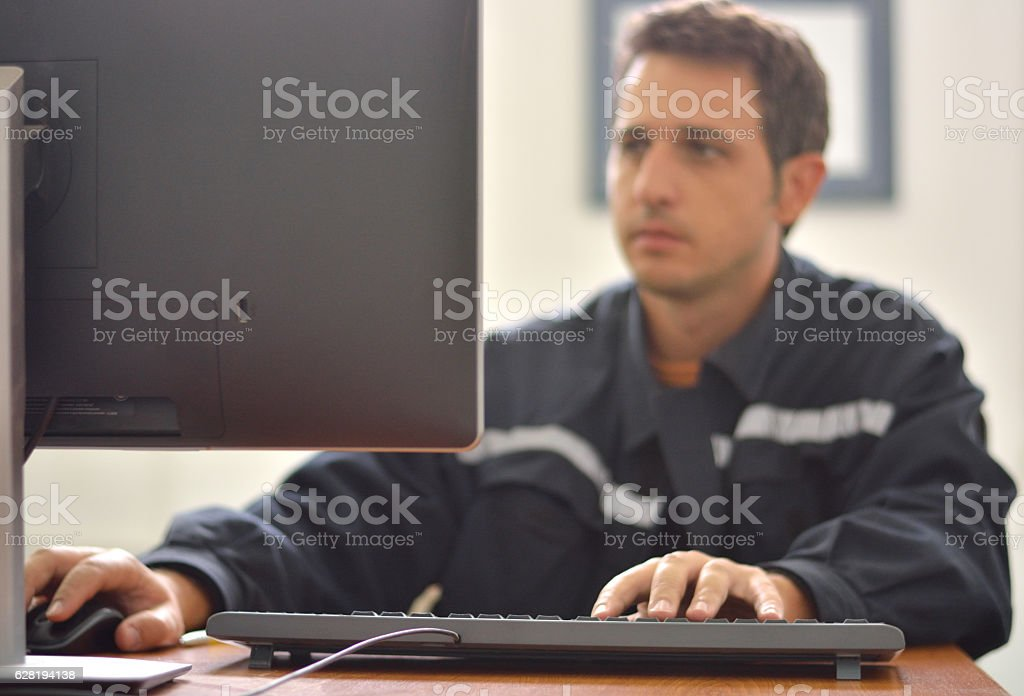 Engineer Works at Desk stock photo