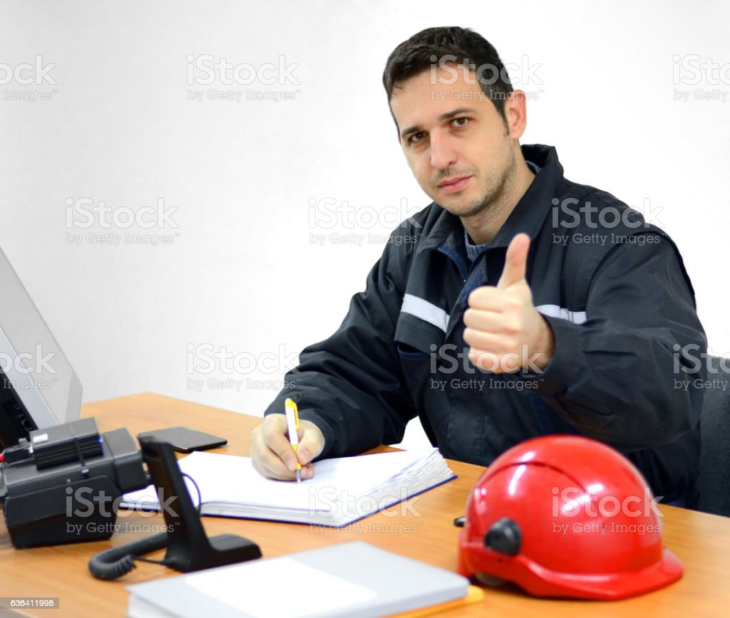 Engineer Works in the Office and Giving Thumbs Up stock photo