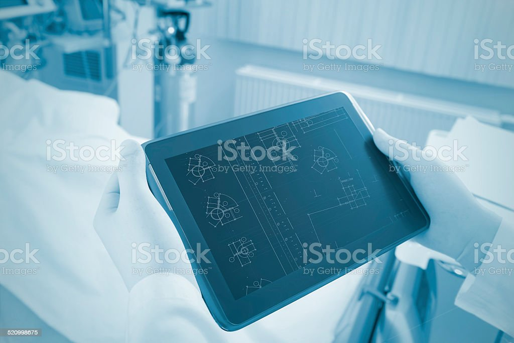 Engineering and technological solutions in medicine. Using the Tablet PC. stock photo
