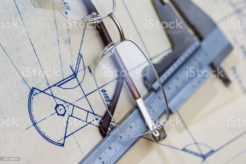 Engineering blueprint with glasses and gauge stock photo