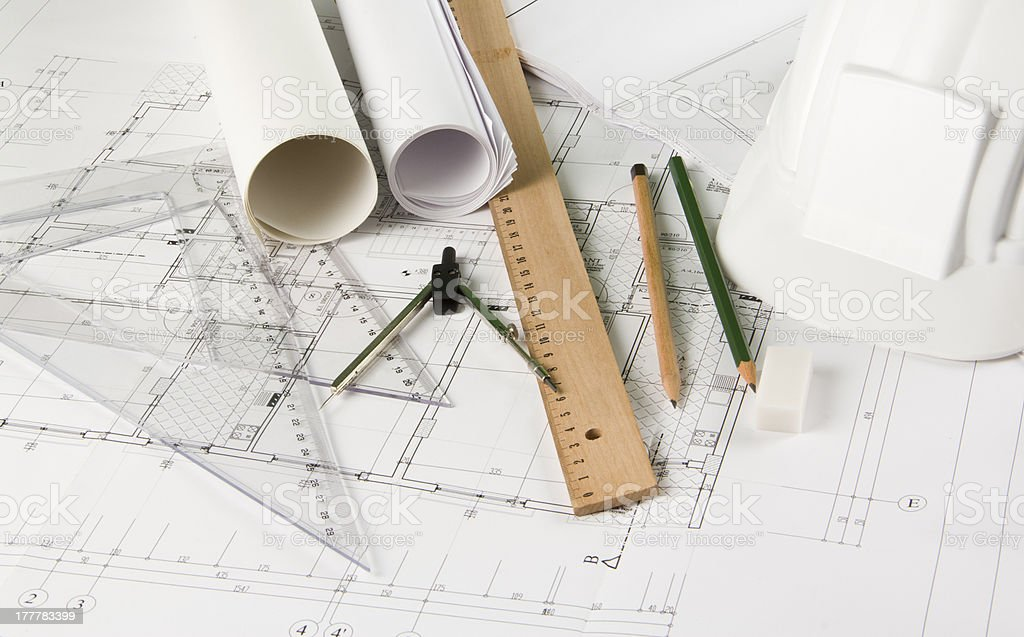 Engineering drawing tools on blueprints royalty-free stock photo