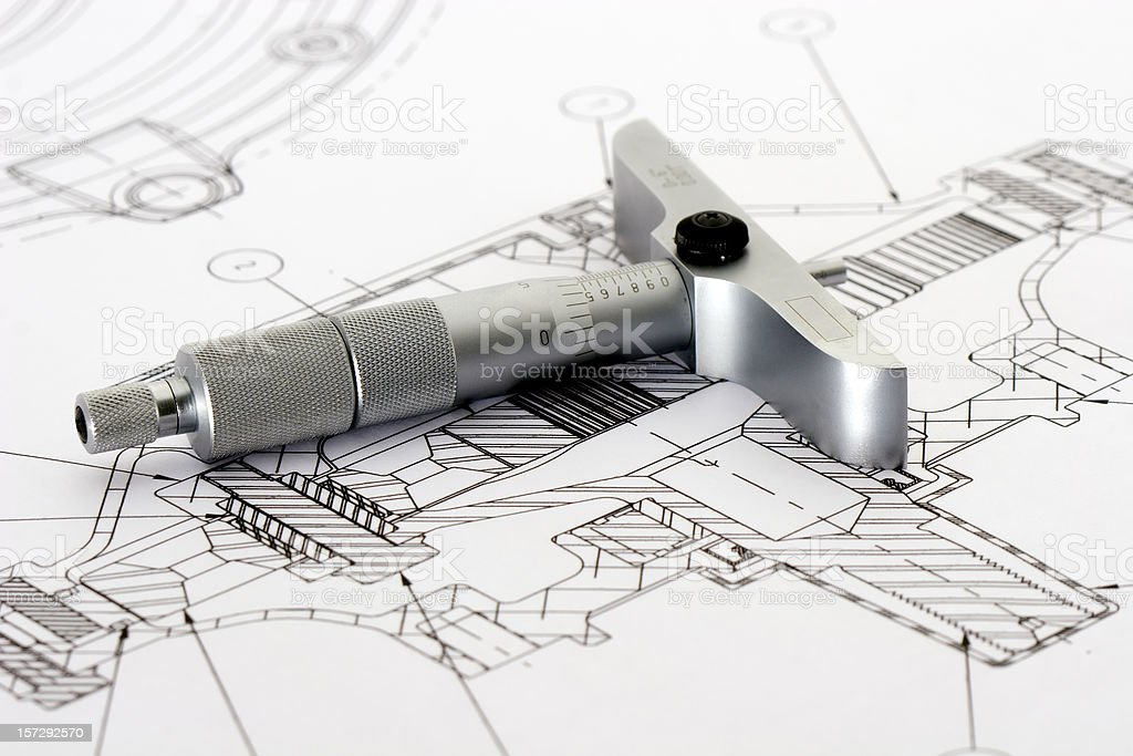 Engineering drawing with tool resting on paper stock photo
