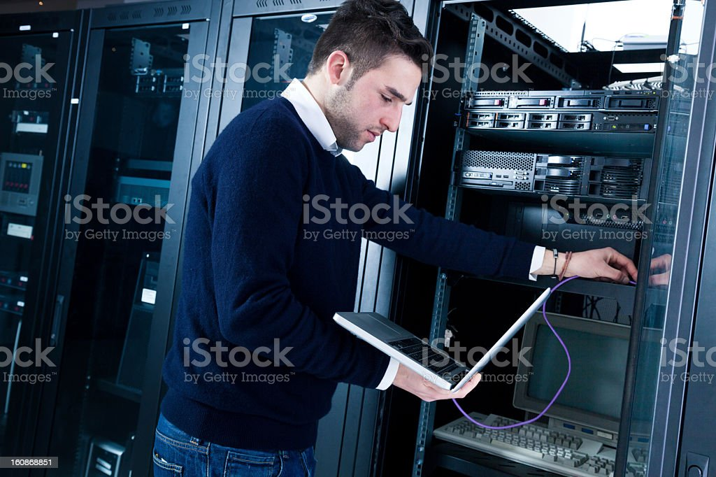 IT engineering fixing computers in the server room stock photo