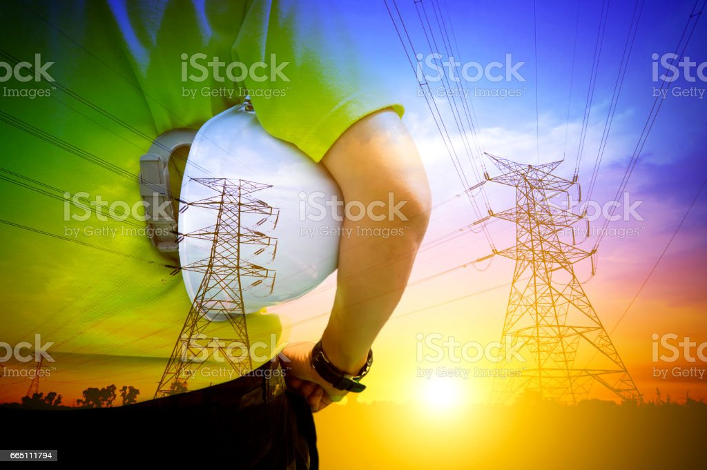 Engineering of Electrical Expertise Concept. Blending with pylons during sunset. stock photo