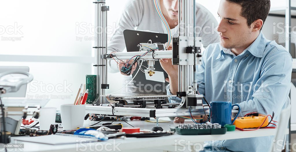 Engineering students using a 3D printer stock photo