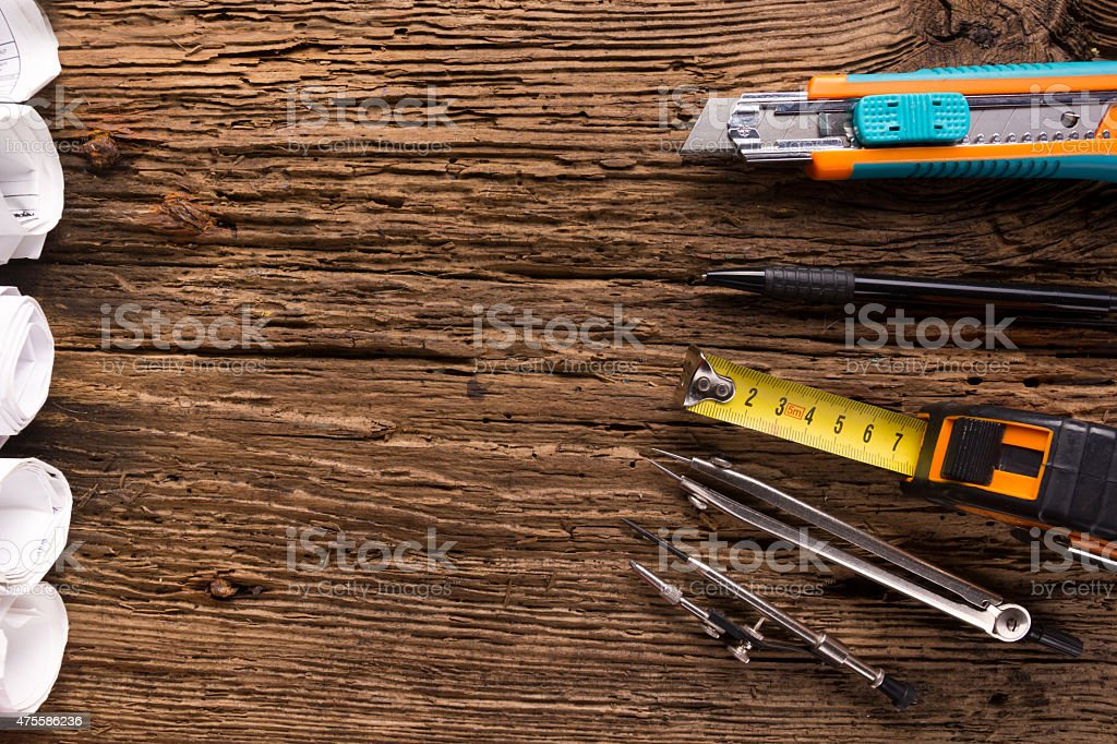 Engineering tools on vintage wooden background stock photo