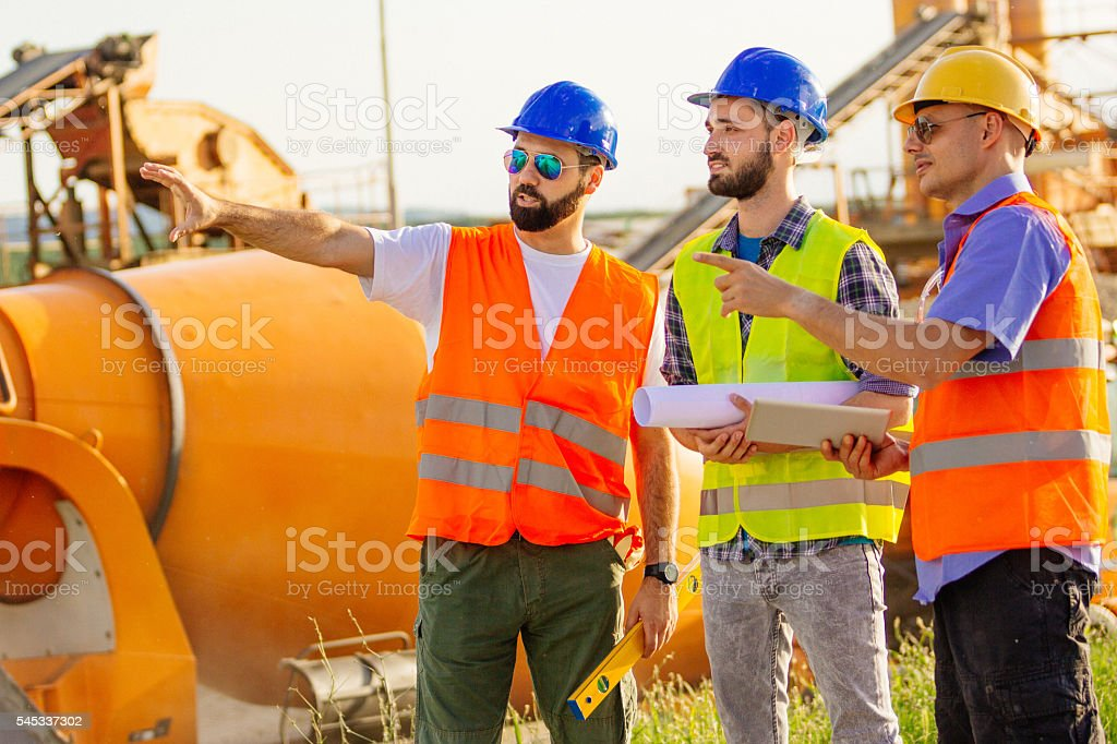 Engineers and architect on construction site stock photo