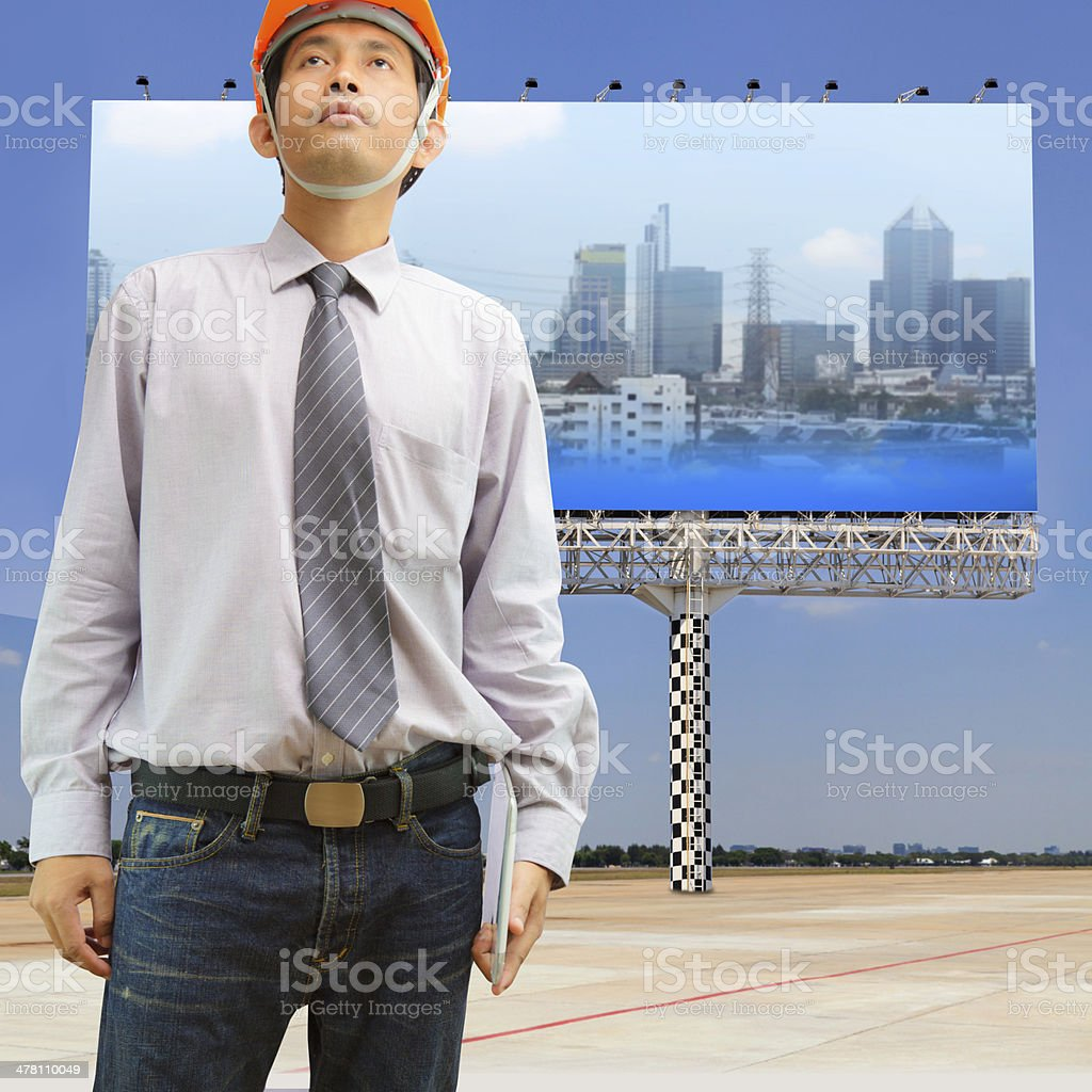 Engineers and architects holding digital tablet royalty-free stock photo