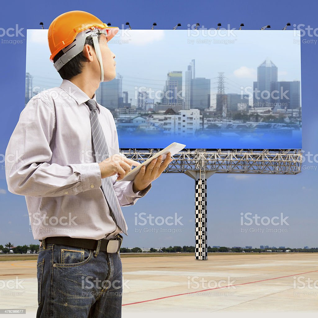 Engineers and architects using digital tablet royalty-free stock photo