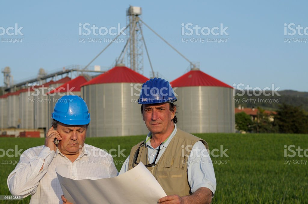 engineers and  grain silo project royalty-free stock photo