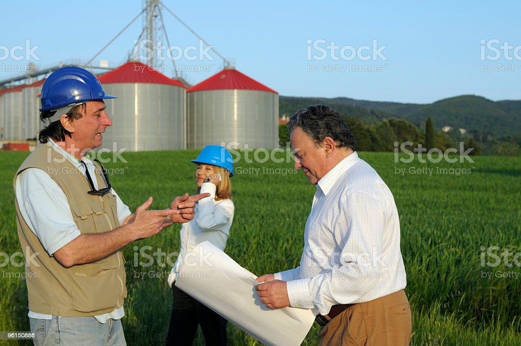 engineers and new grain silos royalty-free stock photo