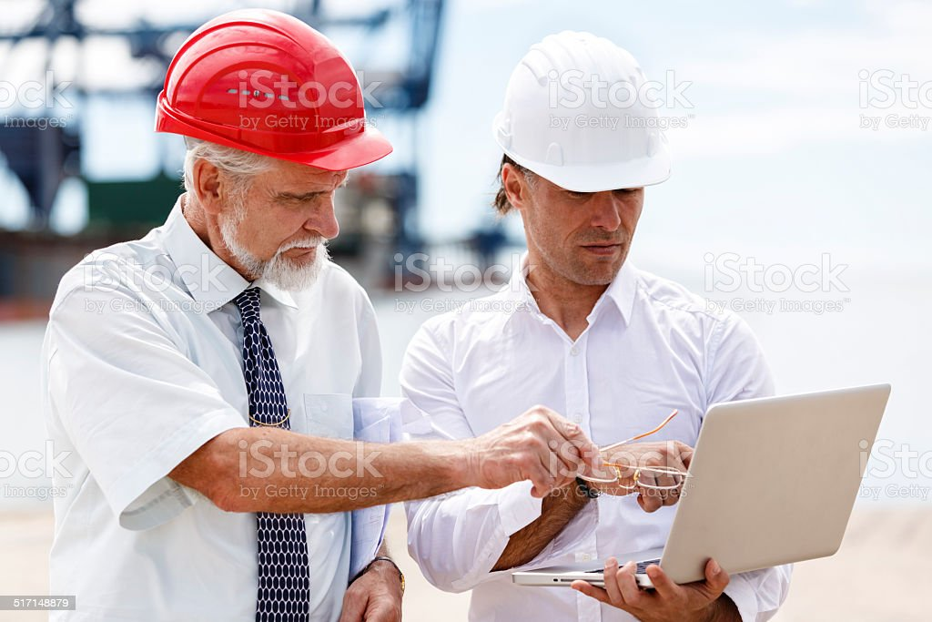 Engineers at commercial dock stock photo