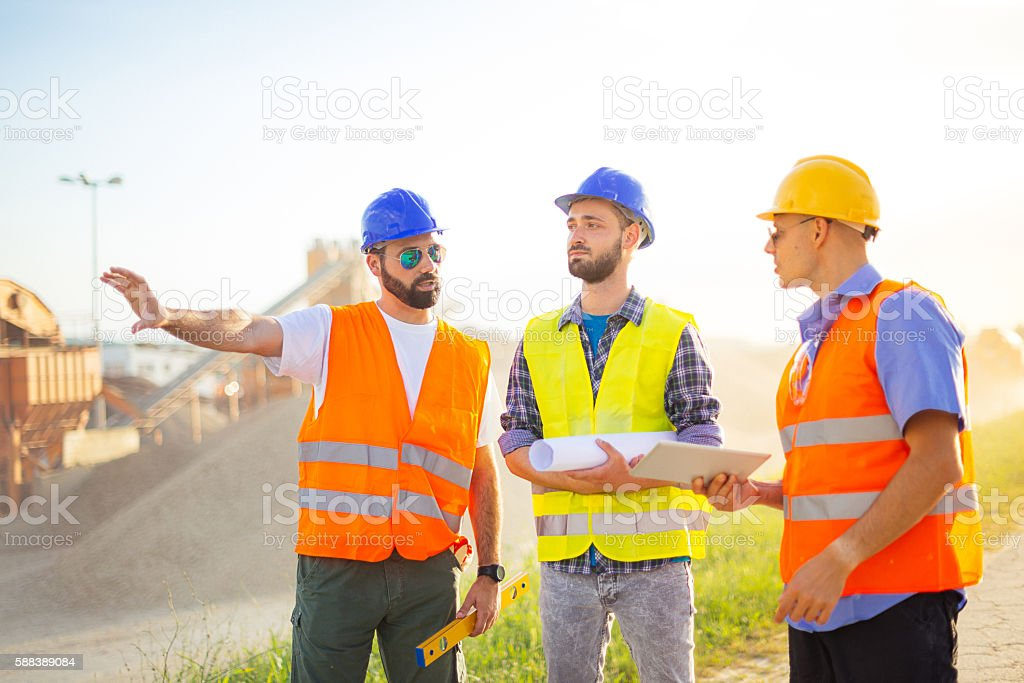Engineers at construction discussing future investments stock photo