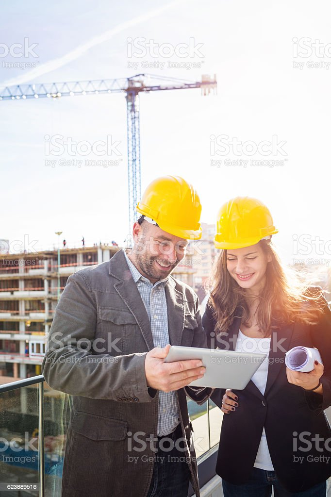 Engineers at construction side stock photo