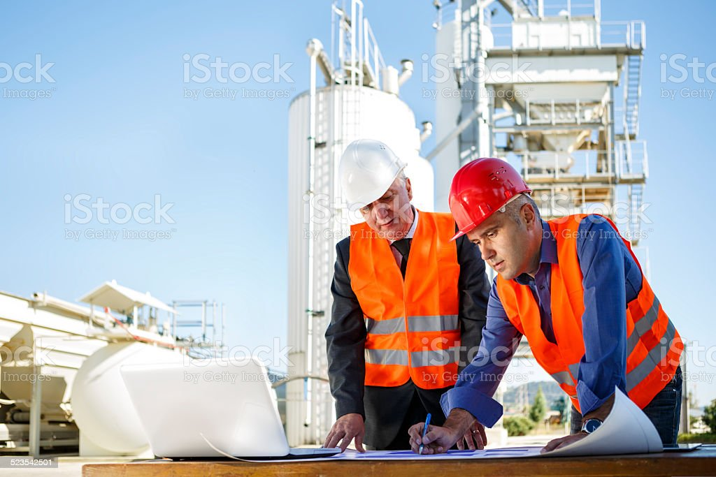 Engineers at industrial facility stock photo