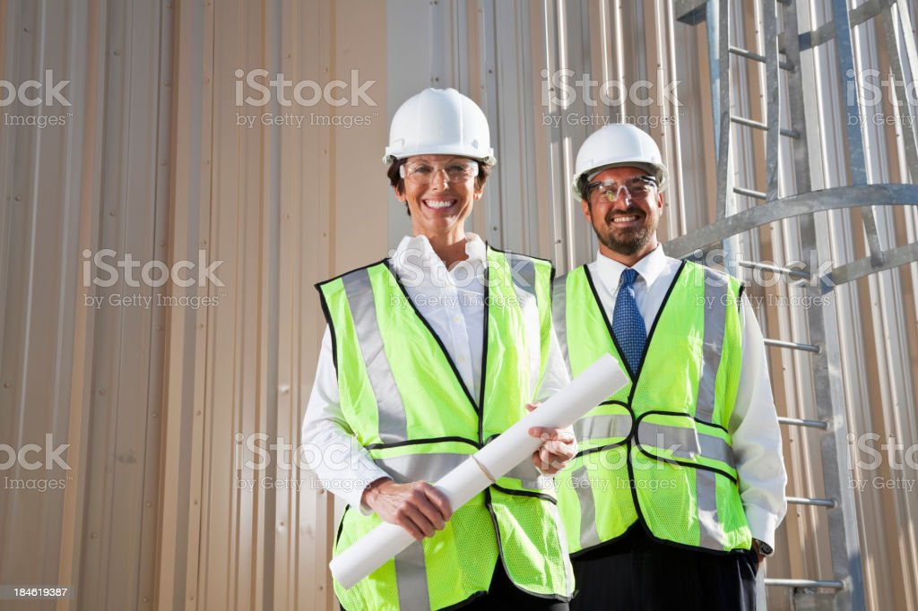 Engineers at industrial site royalty-free stock photo