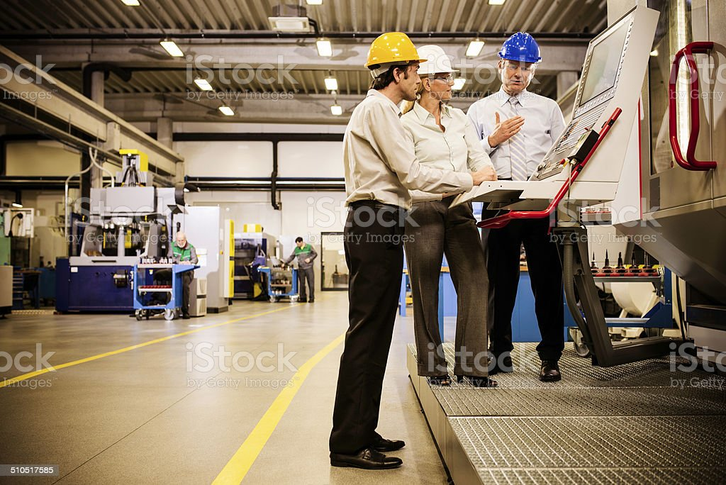 Engineers at the Manufacturing Plant stock photo