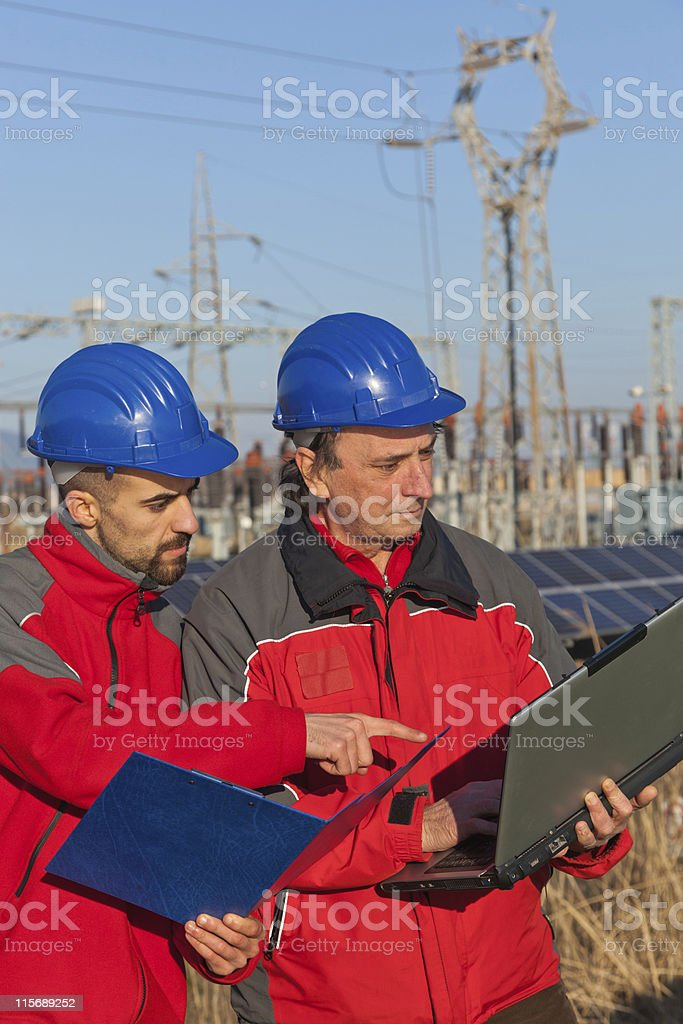 Engineers at Work In a Solar Power Station royalty-free stock photo