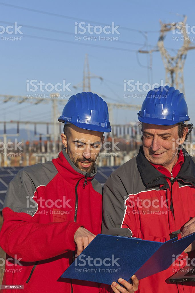 Engineers at Work In a Solar Power Station stock photo
